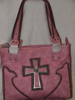 Light pink handbag with accenting cross