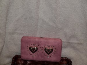 Pink clutch with heart accent