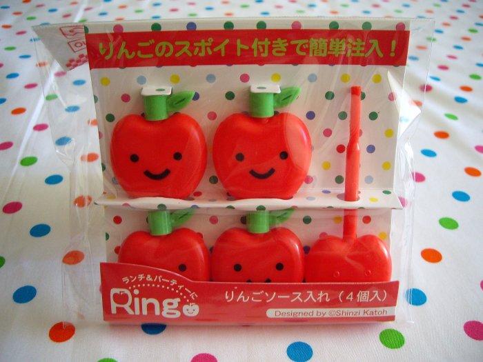 Shinzi Katoh smiling apple ringo sauce bottles