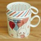 Shinzi Katoh upside-down balloon rabbit cafe mug