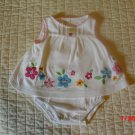Carter's girls one piece sundress decorated with flowers - Newborn