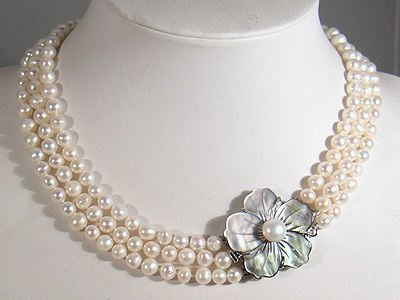 THREE STRING PEARL NECKLACE WITH FLORAL CLASP