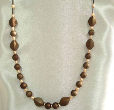 1020S Golden brown wood bead Necklace with glass bead pendant.