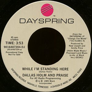 """DALLAS HOLM AND PRAISE--""""""""WHILE I'M STANDING HERE"""""""" (3:53)/""""""""IT'S WAR"""""""" (3:10) 45 RPM 7"""""""" Vinyl"""