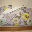 Light lavender with yellow, beige, and teal floral pattern with butterfly appliqués.
