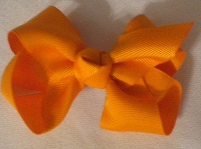 "4 1/2"" orange bow"