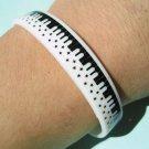 Silicone Rubber Bangle Elastic Belt Bracelet Black Piano Keyboard Music Stars A1184