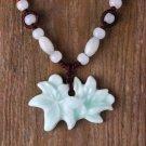 HANDMADE Porcelain celadon carved flower pendant