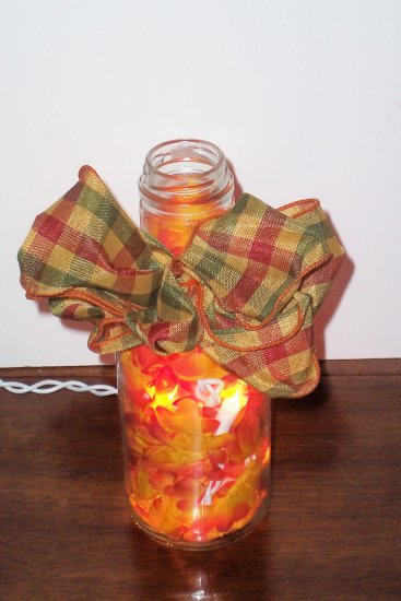 Lighted Bottle with Orange Flowers