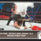 2013 Topps Best of WWE Blue #8 CM Punk Defeats Chris Jericho in a Chicago Street Fight