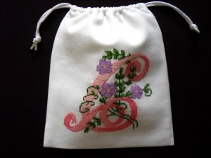"Letter C-cross stitch on 8""x 9""white denim drawstring pouch"