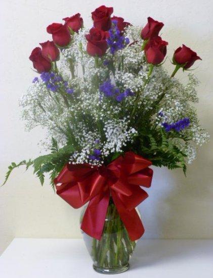 One dozen roses inside vase