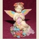 ANGEL FIGURINE WITH RAINBOW WINGS AND ROSES