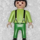 Playmobil - Green Boy - Light Green Torso With Black Suspenders / Green Legs / Black Hair