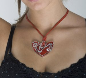 Big, red heart necklace, silver, enamel, gold and diamonds.