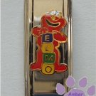 Elmo Super Link Italian Charm playing with blocks to spell name