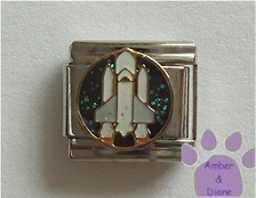 Space Shuttle Italian Charm on a black glitter disc
