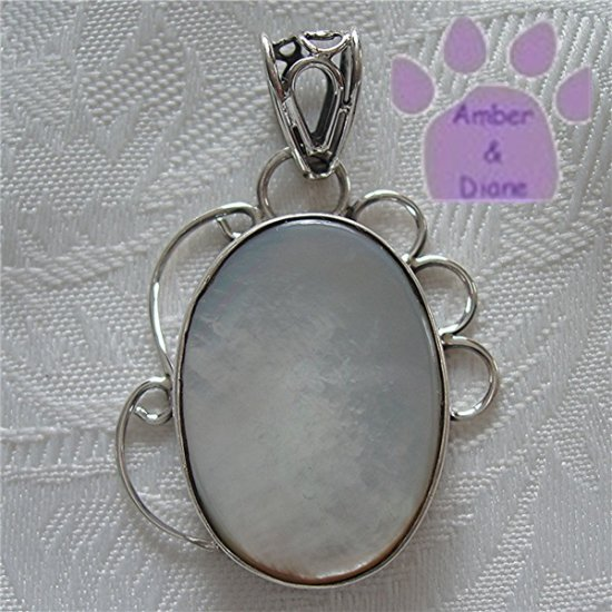 Mother of Pearl Oval Sterling Silver Pendant in a filigree frame