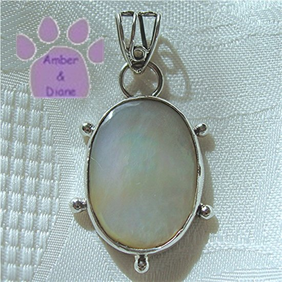 Mother of Pearl Oval Sterling Silver Pendant in a simple frame