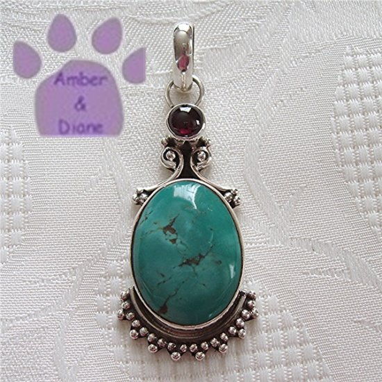 Turquoise Oval and Garnet Round Sterling Silver Pendant