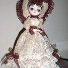 Vintage Bradley Music Box Doll Big Eyed Girl Lace Dress & Hat Plays Feelings #400023