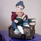 Little Boy Sitting on Trunk Reading Books Music Box Plays It's a Small World #400030