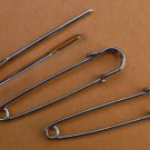 Two stitch holders and two big-eye needle,  steel, 55mm