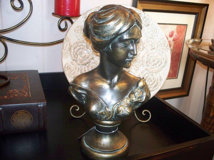 Copper female figurine
