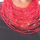 red multi-string necklace