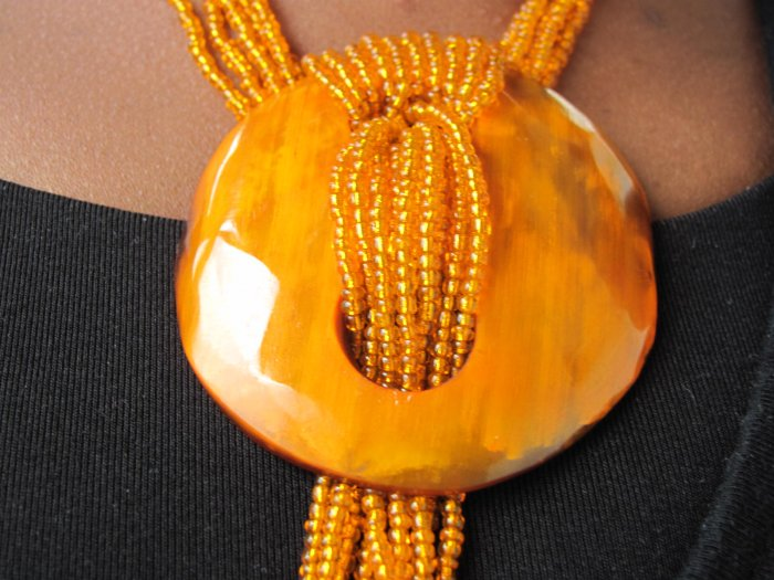 long orange multi-string necklace