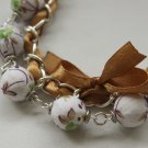 White floral cotton beads and brown satin ribbon bracelet