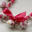 Cotton beads and pink satin ribbon bracelet