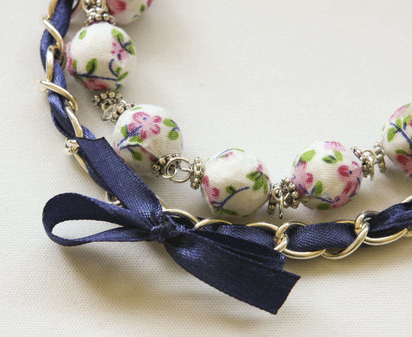 Cotton beads and blue satin ribbon bracelet