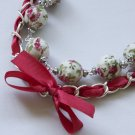 White floral cotton beads and red satin ribbon bracelet