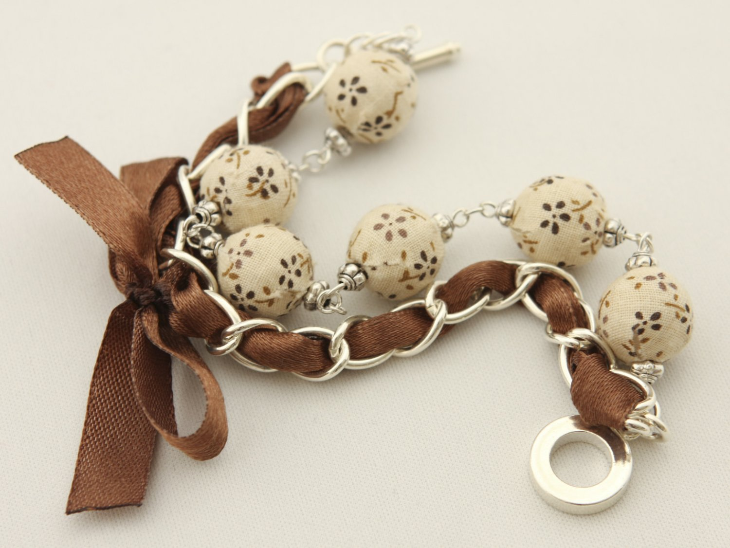 Cream floral cotton beads and brown satin ribbon bracelet