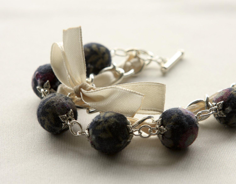 Black floral cotton beads and beige satin ribbon bracelet