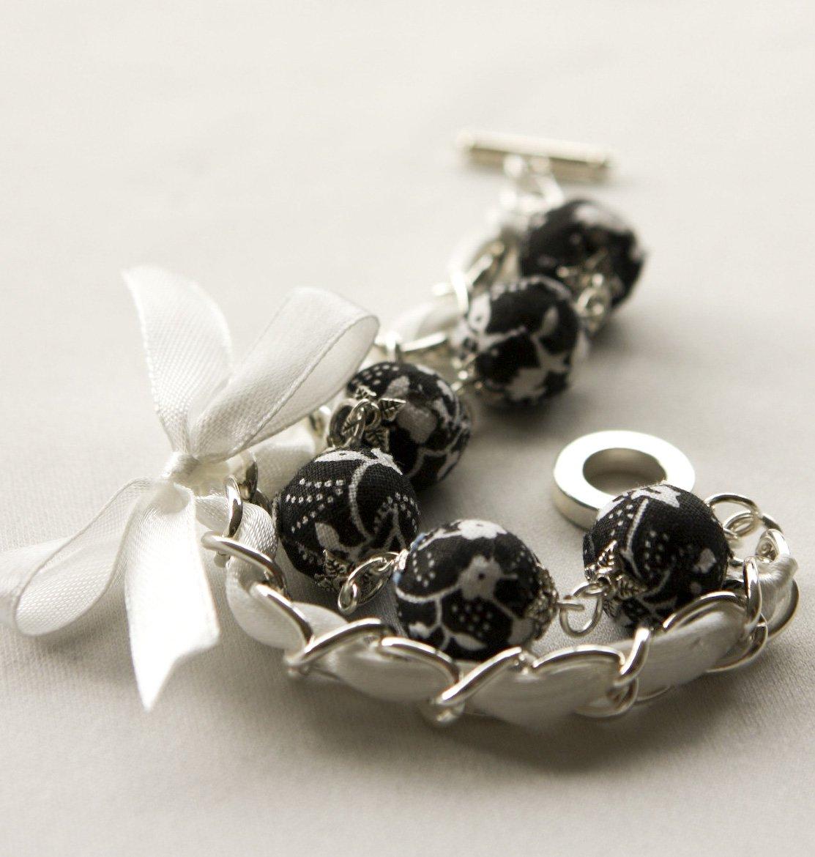Black fabric beads and white satin ribbon bracelet