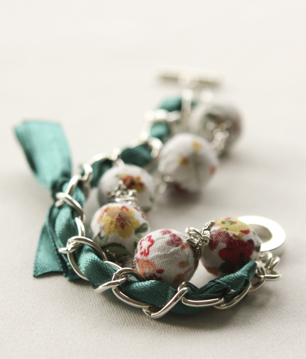 White floral fabric beads and emerald satin ribbon bracelet