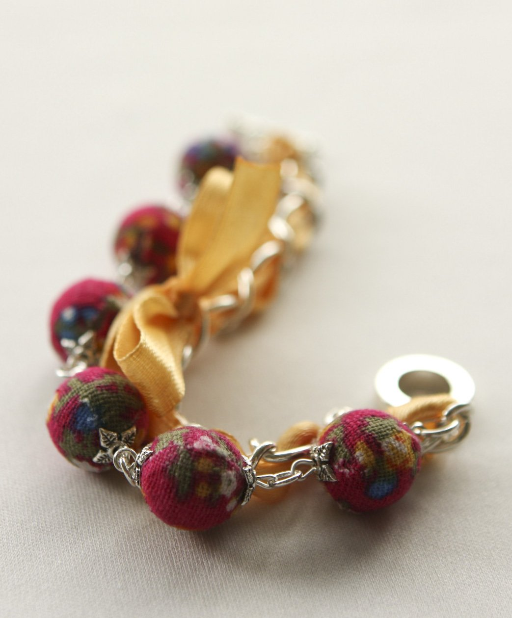 Red cotton beads and yellow satin ribbon bracelet