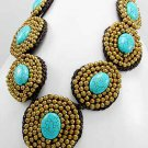Beach wicker necklace made with gold-torquise stones