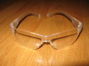 25 PAIR CLEAR SAFETY GLASSES NEW IN PACKAGE