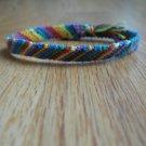 "Handmade red, green, blue, purple, orange and yellow Candy Stripe friendship bracelet 7"""