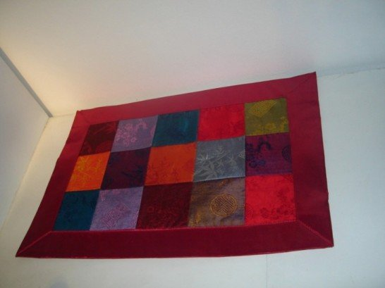 Patchwork placemat in red
