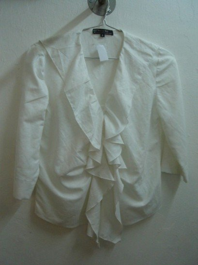 White ruffled linen blouse