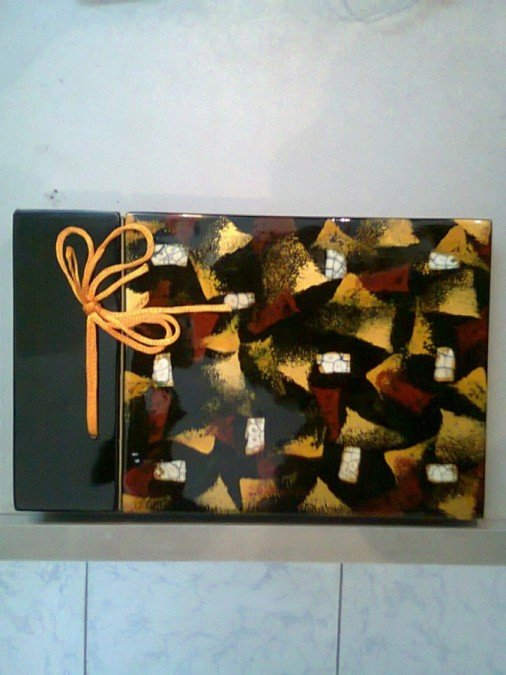 Lacquer album with inlaid egg