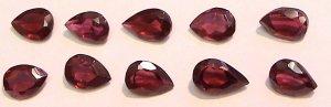 Set of FIVE 6 x 4 mm pear shaped Garnet Gems