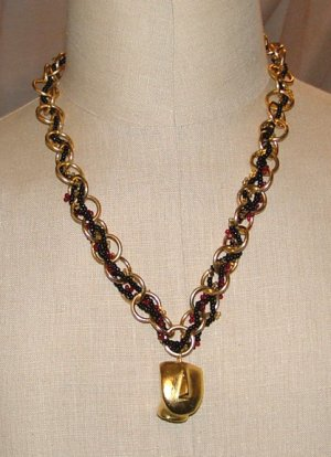 Chain and beaded necklace with face pendant