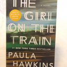 The Girl on the Train Paula Hawkins soft cover NYTs best seller made into movie as new AL1546