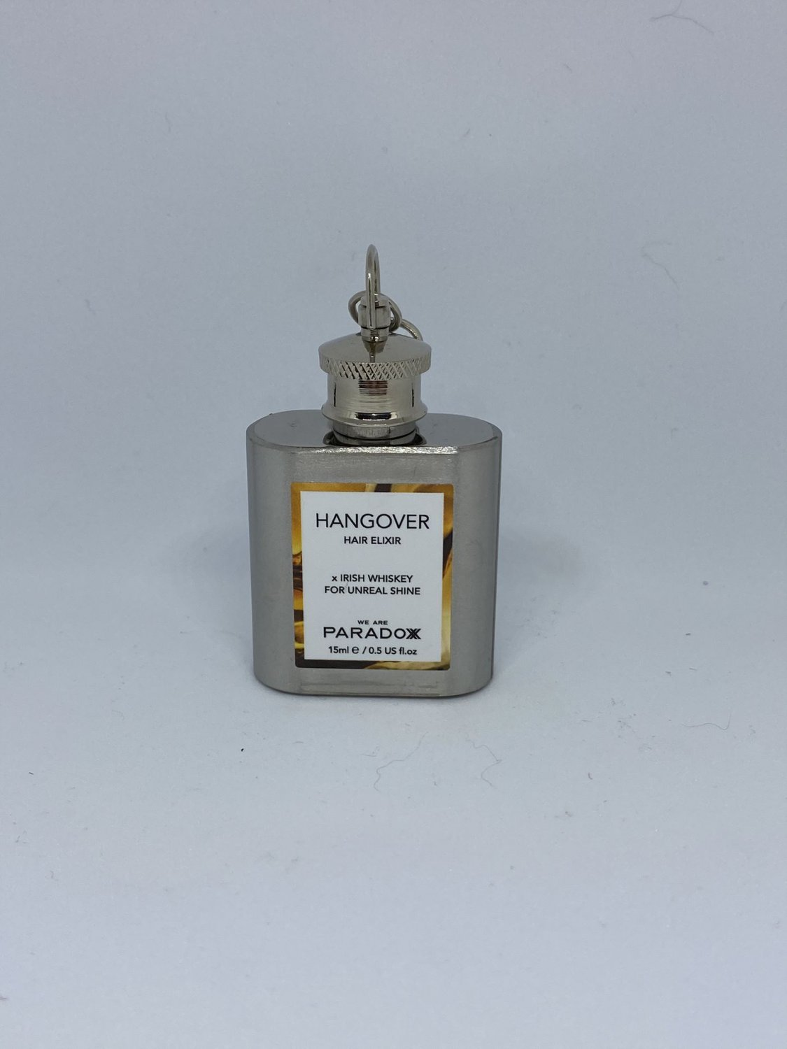 We Are Paradoxx Hangover Hair Elixir with Irish Whiskey Travel Size Treatment in Mini Flask