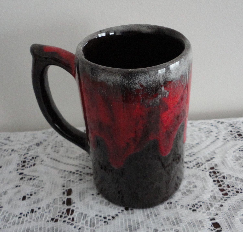 Vintage Pottery Big Beer Mug Lava Drip Red on Dark Brown.